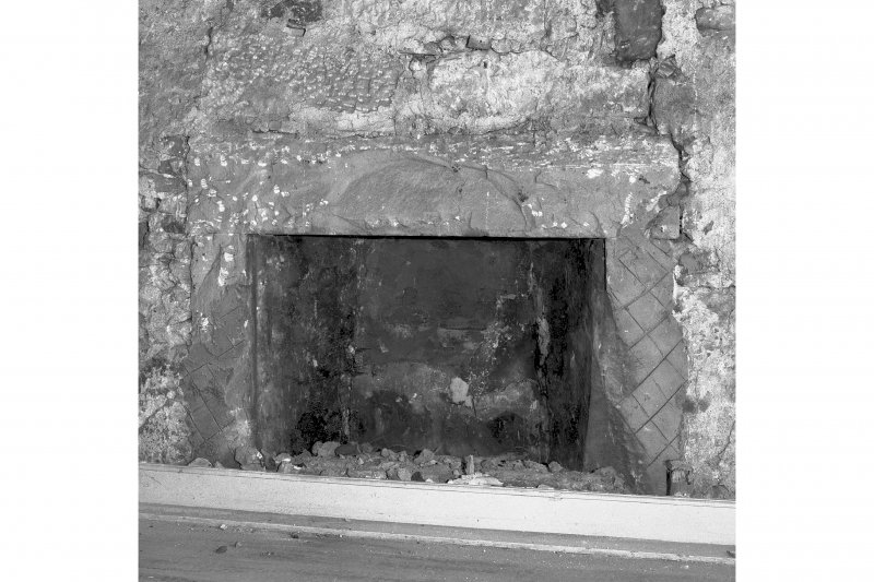 View of fireplace in East wall, room 15