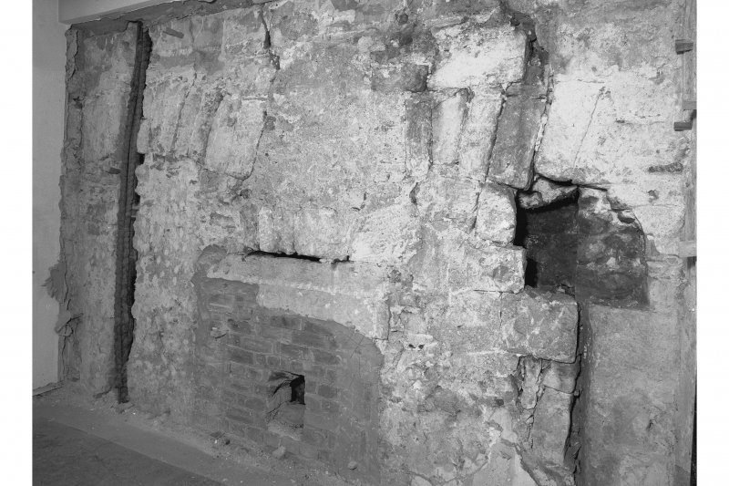 View from South West showing blocked opening and blocked fireplace, room 16