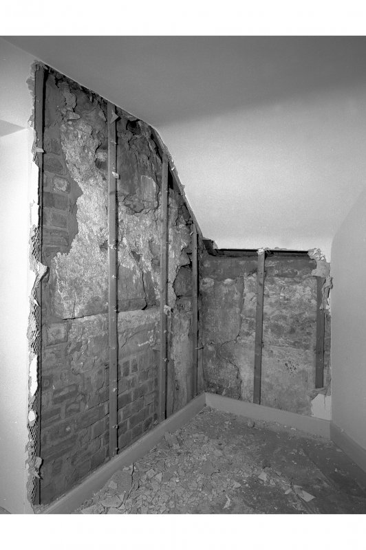 View from west of moulded stone in situ, room 28