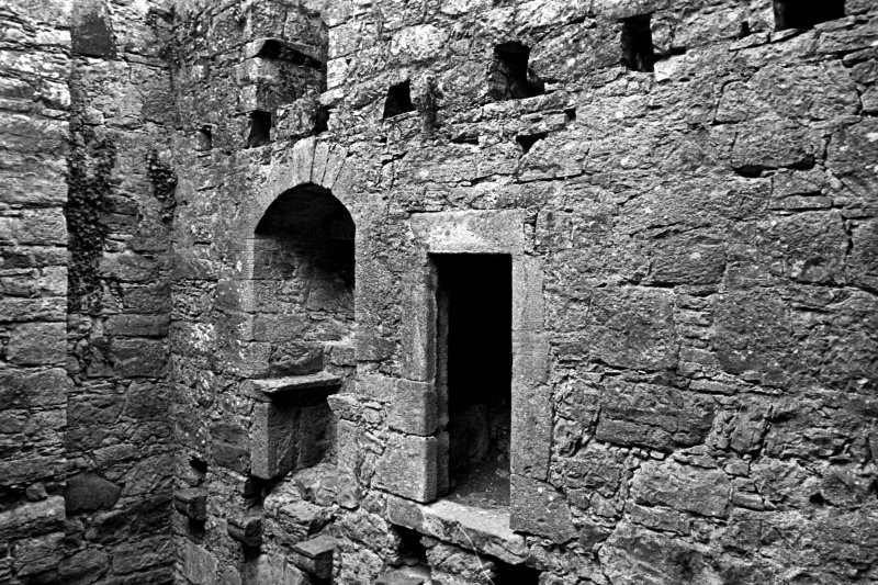 Interior. Second floor, detail of NE wall window embrasure and garderobe entrance.