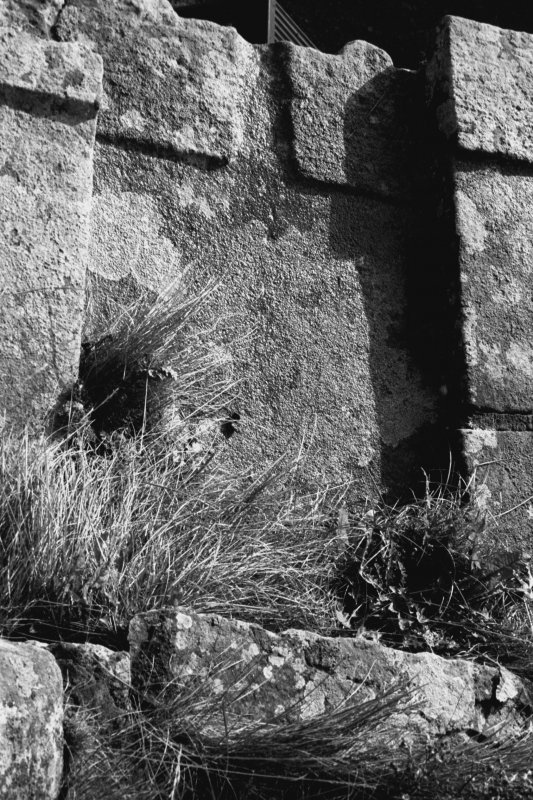 Detail of parapet showing flagstone with drainage outlet.