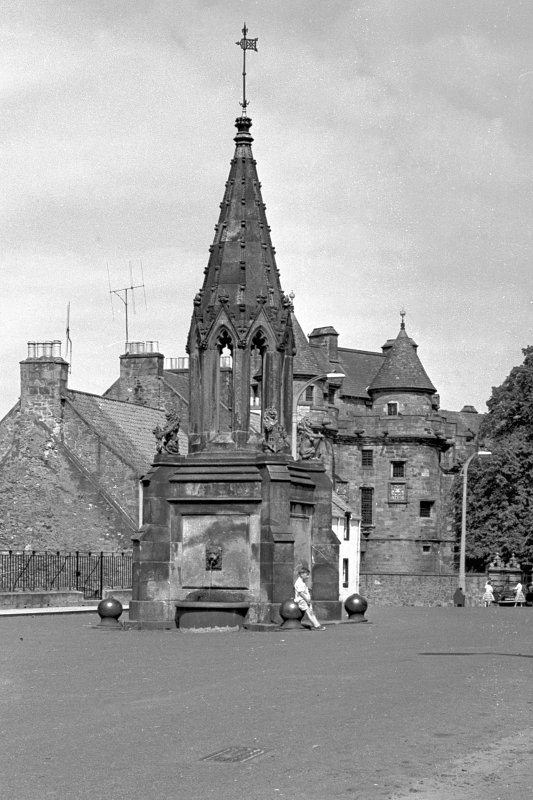 General view from east of Bruce Fountain, with Falkland Palace in the background.