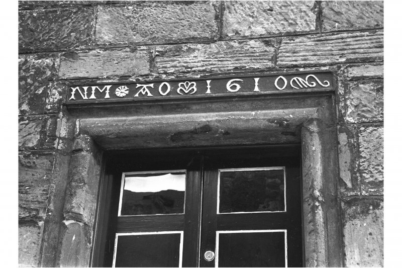 Detail of lintel inscribed 'NM AO 1610' above door of Moncrief House, High Street, Falkland