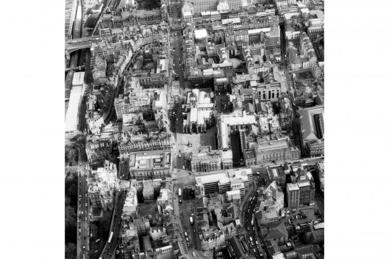 Aerial view of centre of Edinburgh including Market Street on left of photograph, North and South Bridges at top, George IV Bridge to right and Upper Bow at bottom