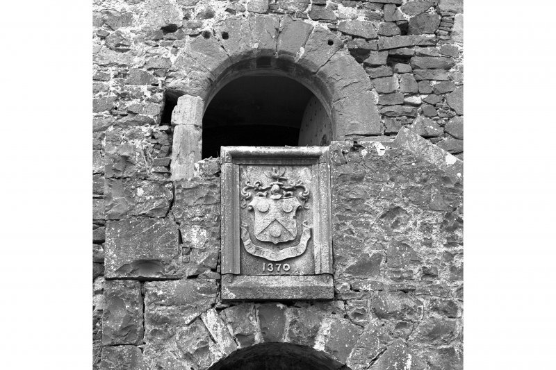 Detail of 19th century armorial built into original main entrance of tower (E stair)