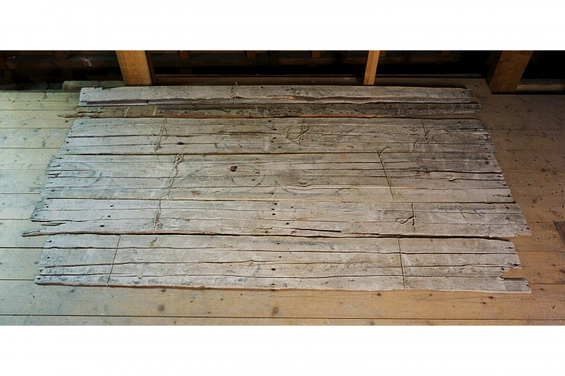 View of painted planks from ceiling of chapel vestibule.