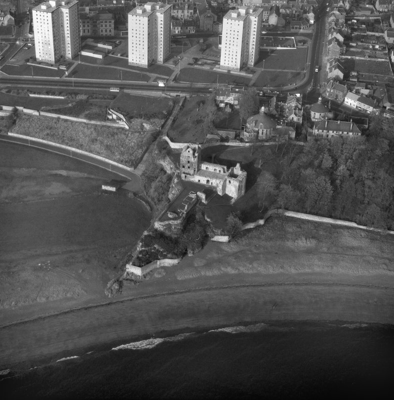 Oblique aerial view from South East of Ravenscraig Castle. Includes Pathhead tower blocks.