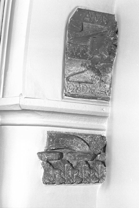 Interior-detail of carved fragments inside church on East wall