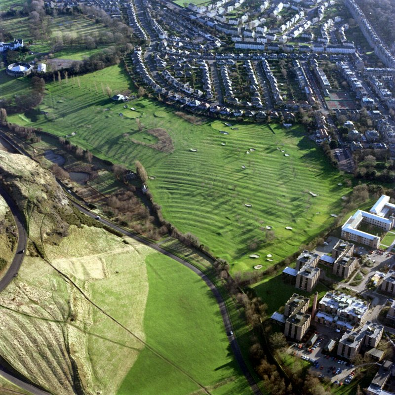 Oblique aerial view of Prestonfield centred on a golf course and rig, taken from the NNW.