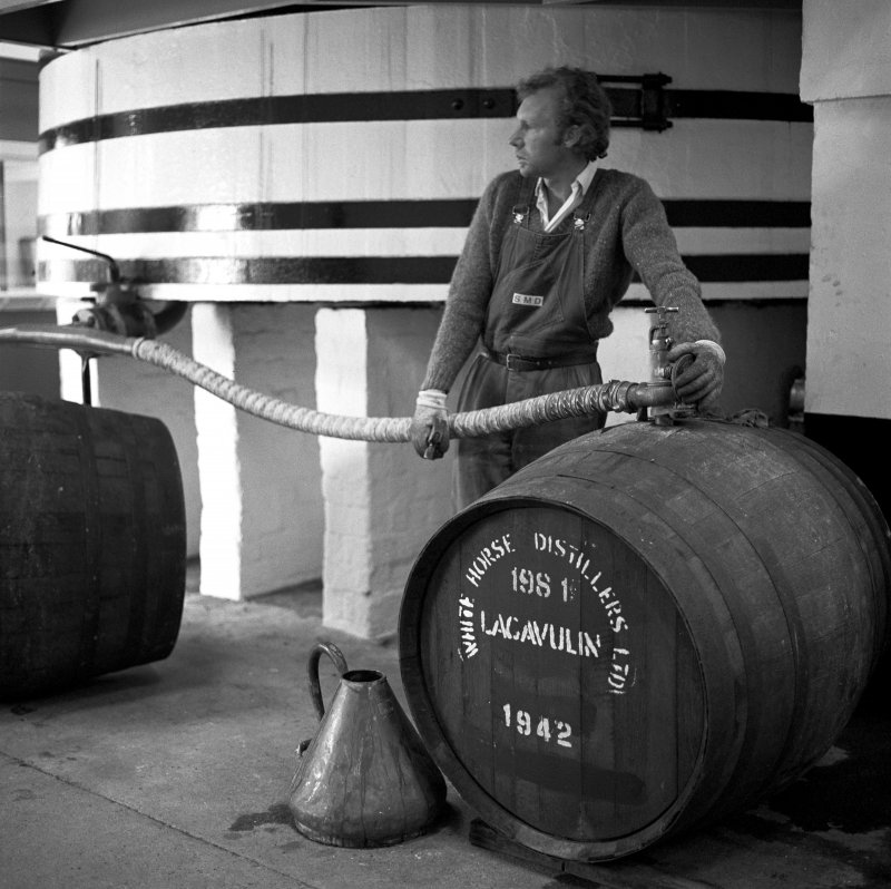 Lagavulin Distillery, Filling Store. View of man 'cask-filling'.
