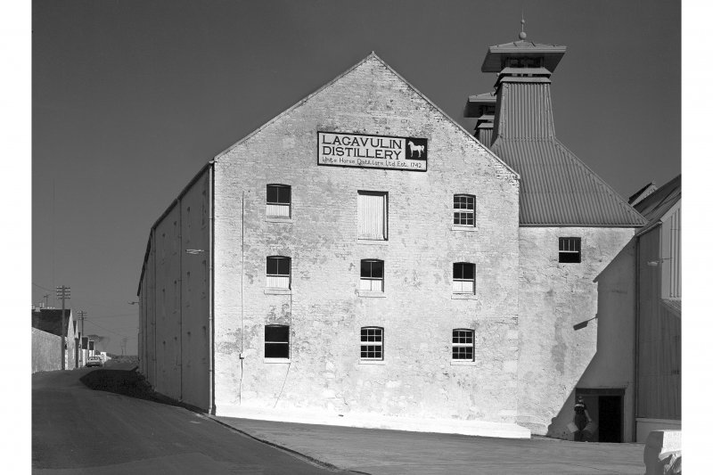 Lagavulin Distillery, Old Malt Barn. View from West, showing plaque reading 'Lagavulin Distillery, White Horse Distillers Ltd. Est. 1742'