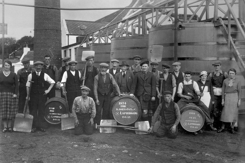 Laphroaig Distillery. View of workers group, including Mrs Wishant-Campbell, alias Miss B. Williamson, far right. Also including range of worm-tubs in background, demolished c.1960.