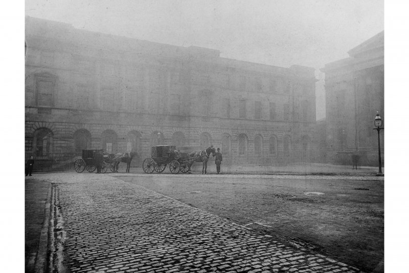 General view of Signet Library looking from High Street, with two horses and carriages in front of building