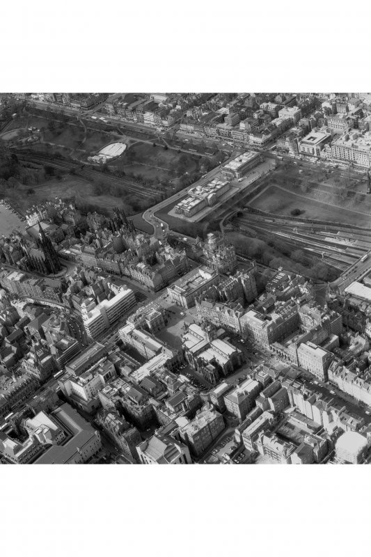 Oblique aerial view of centre of Edinburgh including Princes Street at top of photograph, Waverley Bridge to right, Parliament Square, High Court of Justiciary to bottom and Castlehill to left