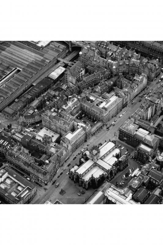 Edinburgh. Oblique aerial view showing High Street between North Bridge and Lawnmarket with St Giles' Cathedral on right and City Chambers on left