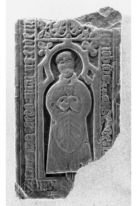 Chapel, Texa, Islay. Detail of fragment grave-slab with priest (IB199).