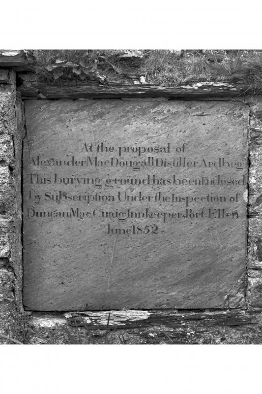 Kilnaughton Chapel, Kilnaughton. View of inscribed panel in churchyard wall. Insc: 'At the proposal of Alexander MacDougall, Distiller Ardbeg, this burying ground has been enclosed by subscription under the inspection of Duncan MacCraig inkeper, Port Ellen. June 1852'.