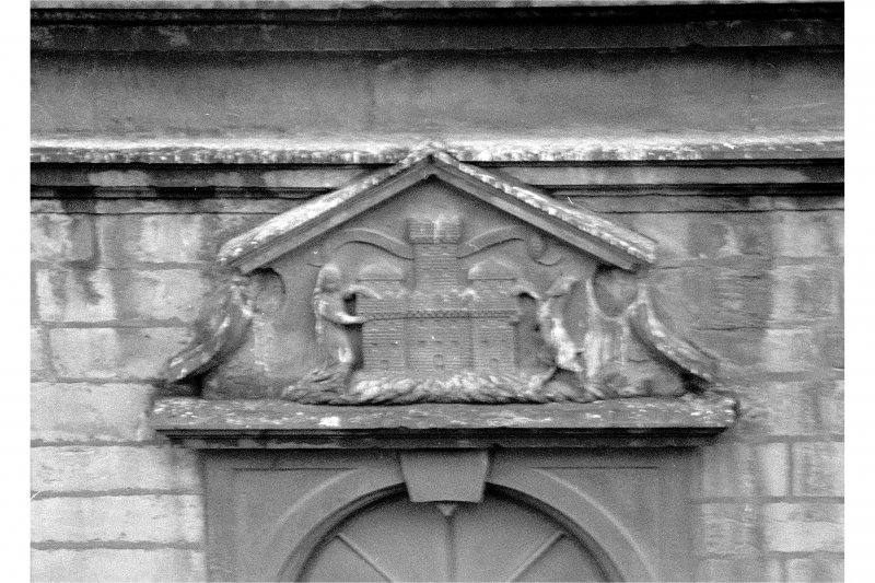 Detail of carved pediment above doorway