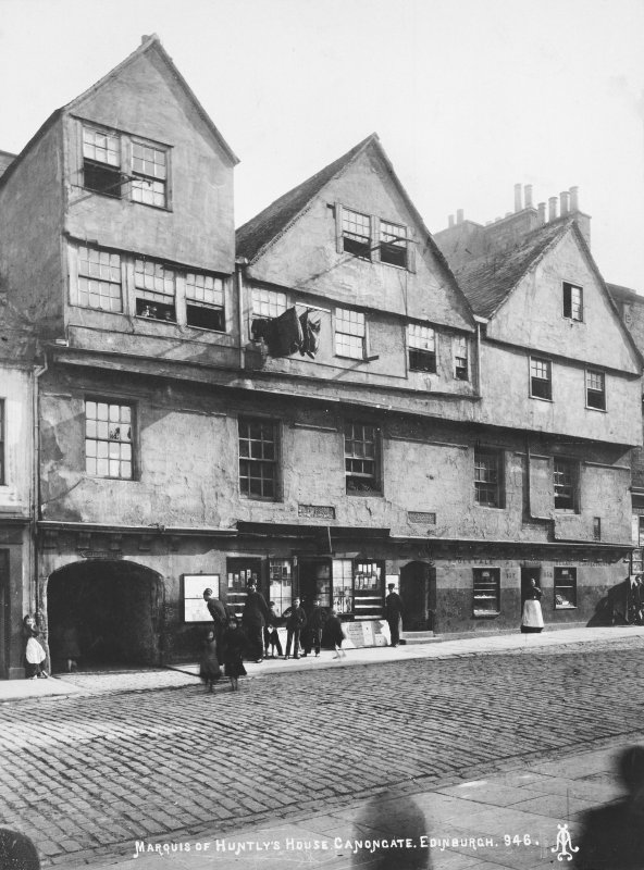 View of street facade, insc: 'Marquis of Huntly's House, Canongate, Edinburgh. 946. A.I.' showing shops including C Williams Wholesale and Retail Confectioner