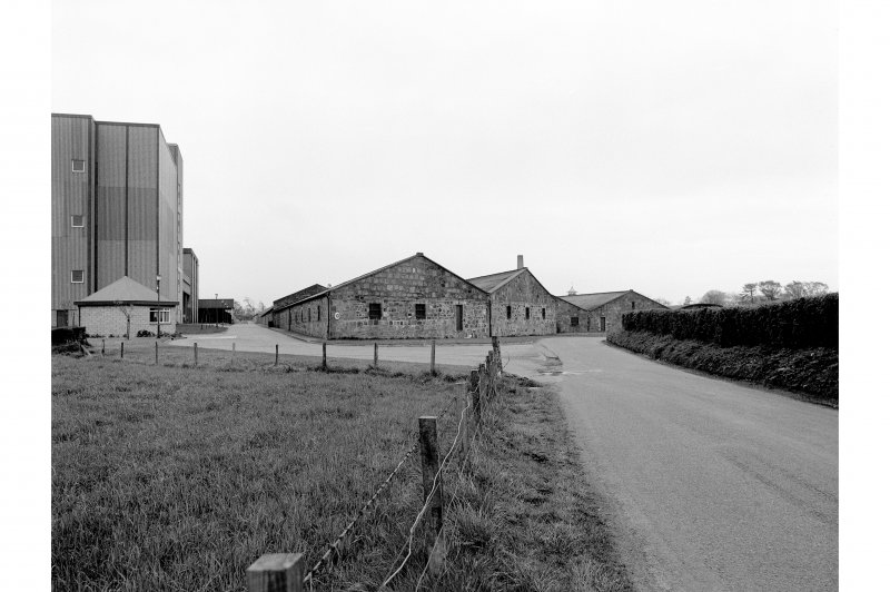 View from SW showing S blocks of duty-free warehouses, with Glenesk Maltings buildings on the left