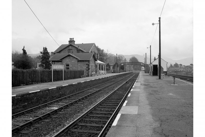 Blair Atholl Station View looking E showing main building, footbridge and wooden shelter