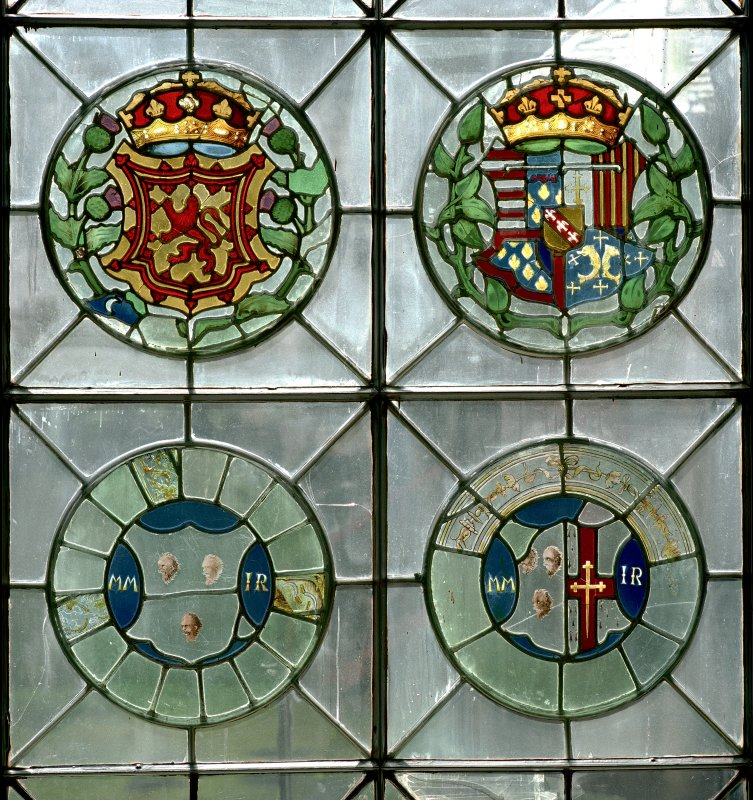 Scan of D 46531/CN. Detail of armorial panels on stained glass window in Magdalen chapel.