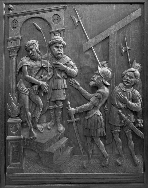 Traquair House chapel, interior Detail of carved oak panel showing the Pontius Pilate delivering Our Lord to the Captain to be Crucified