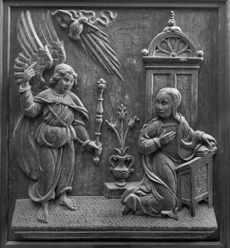 Traquair House chapel, interior Detail of carved oak panel showing the Annunciation