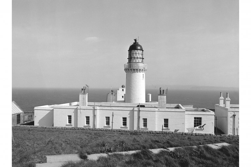 Scanned image of a photograph showing  Dunnet Head Lighthouse, view from S showing main building and tower