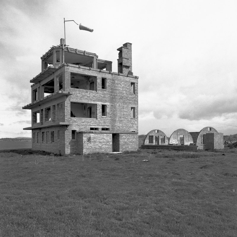 Fearn Airfield Naval Control Tower, view from S showing rear elevation of tower and Nissen hut to the rear.