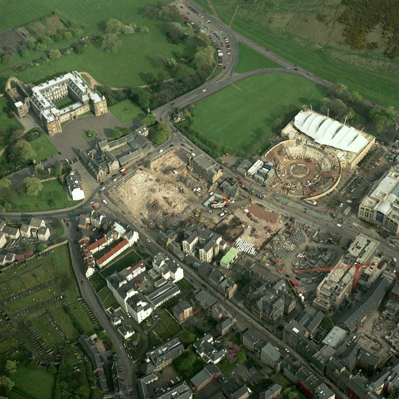 Oblique aerial view of Edinburgh centred on the construction of the Scottish Parliament with the 'Our Dynamic Earth' building and Holyrood Palace adjacent, taken from the WNW.