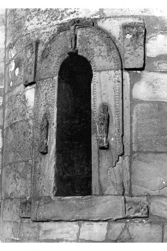 Historic photographic view of doorway in round tower.