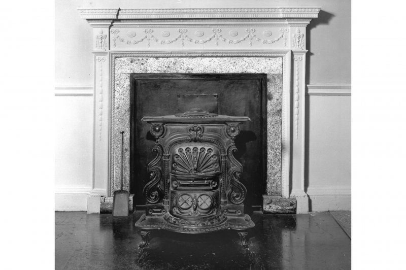 Interior. View of fireplace and stove in entrance hall.