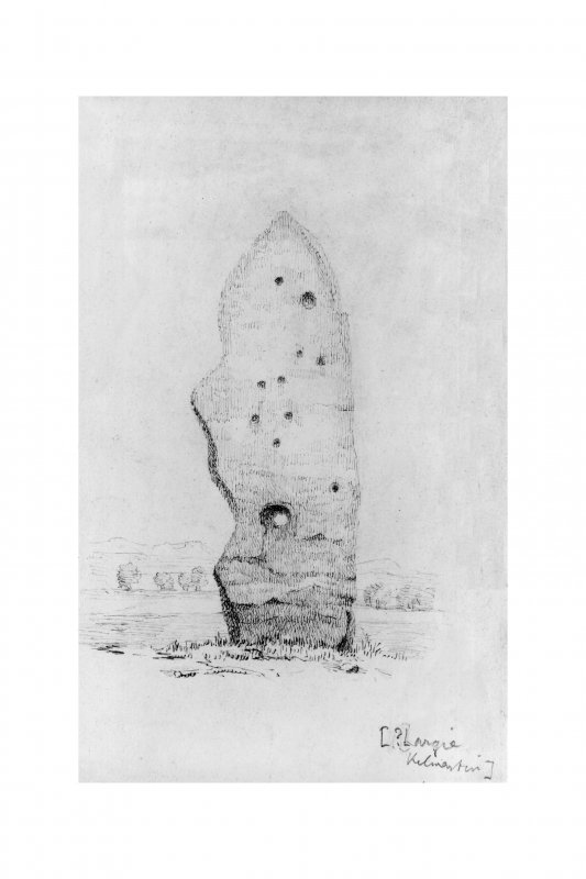 Holed stone with cup-marks.