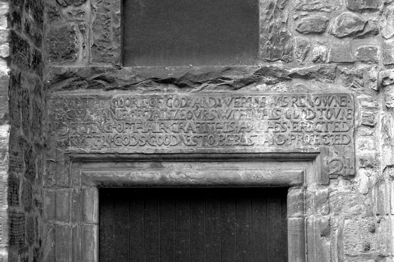 Detail of inscribed lintel above North East wing main entrance
