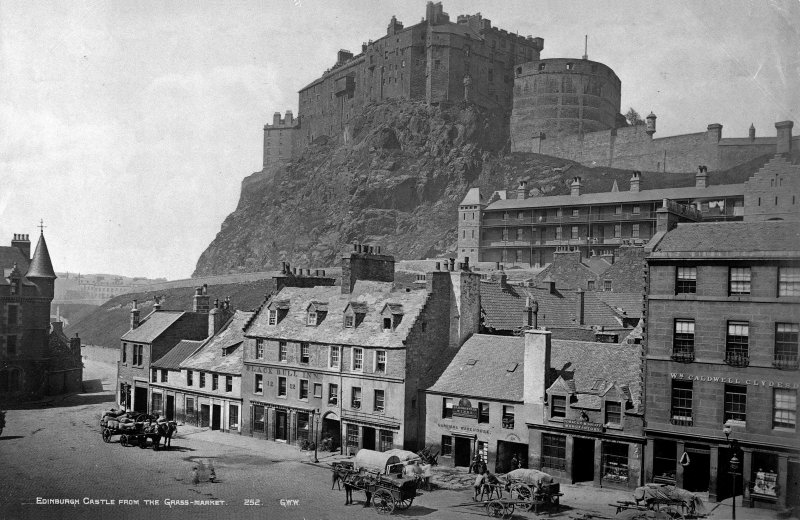 View of Edinburgh Castle and nos 1 and 10 - 28 Grassmarket including the Black Bull Inn, Carriers Warehouse, a tobacco and snuff manufacturer and W Caldwell Clydesdale Insc: 'Edinburgh Castle From The Grass-Market.   252. GWW.'