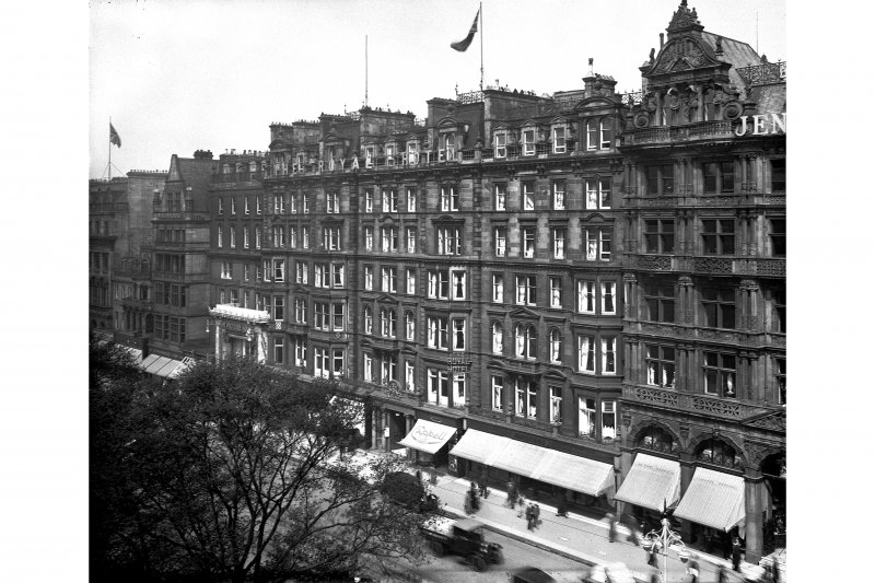 General view of Nos 47 - 59 Princes Street showing awnings on shop fronts and cars parked outside