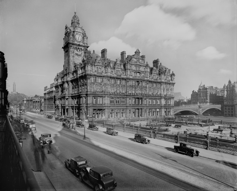 View from north west of the North British Station Hotel also showing Waverley Gardens, the North Bridge, Calton Hill, Waterloo Place and cars parked on the street.