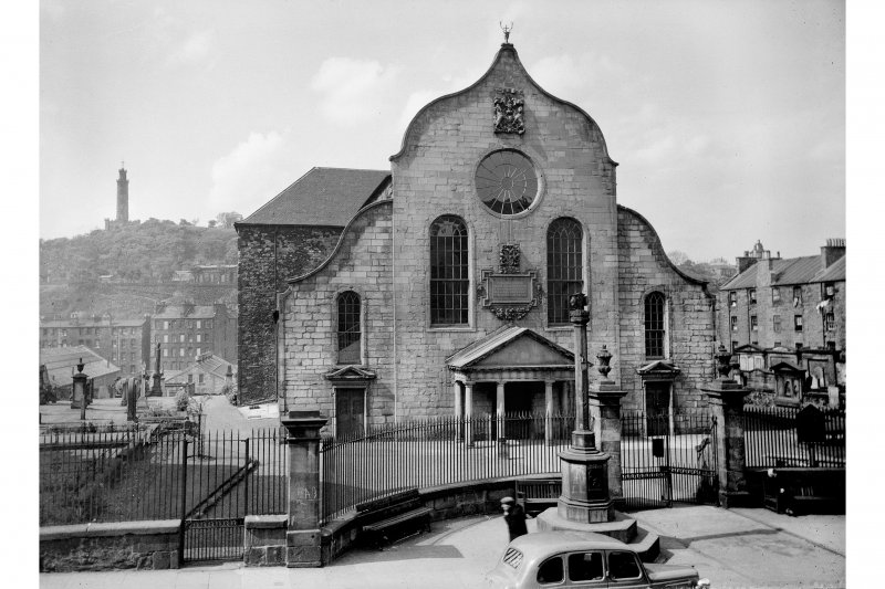 View of Canongate Church from South South West, also showing Burgh Cross in front of church and Nelson's Monument behind.