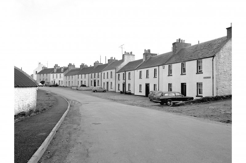 Islay, Port Charlotte General view from N showing NE front of cottages on N tip of Main Street