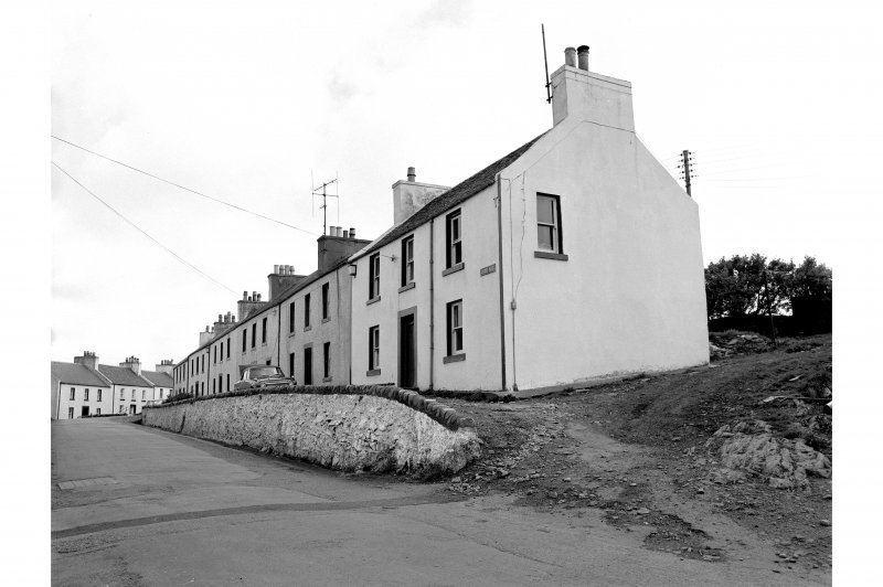 Islay, Port Charlotte General view from N showing cottages on Main Street whose main entrances point ENE