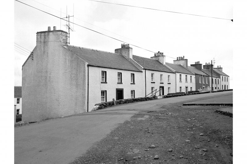 Islay, Port Charlotte General view from N showing cottages on Main Street whose main entrances point WNW
