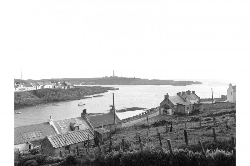Islay, Portnahaven, 1-23 King Street, Terraced Cottages View from NE showing NW front of numbers 15-23 and NE corner of pier with Islay lighthouse in distance