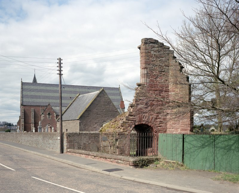 General view of gate-house and abbey church, from S