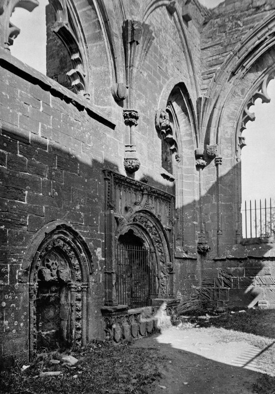 Historic photograph. View of sacristy door and monument to Margaret Countess of Douglas.