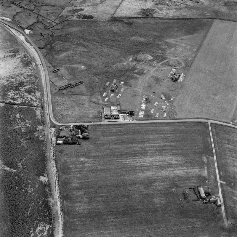 Hoy, Doonatown, oblique aerial view, taken from the NE, centred on The Garrison Theatre, Lyness Military Headquarters and Camp, and a ruined farmstead.