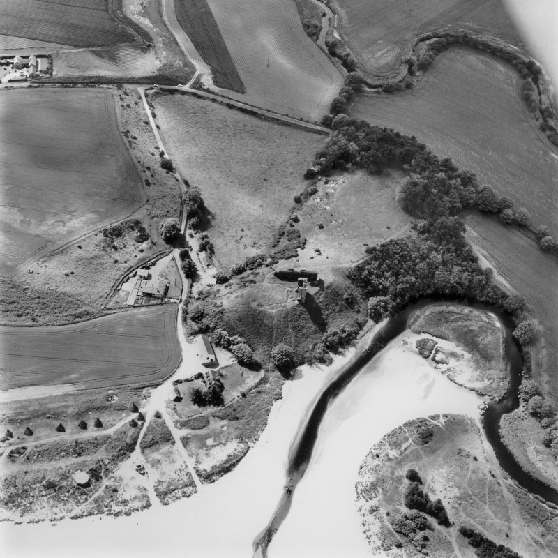 Red Castle, oblique aerial view, taken from the ESE, centred on the remains of Red Castle. The cropmarks of an unenclosed settlement and a barrow cemetery are visible in the top left-hand corner of the photograph, and a pillbox and anti-tank blocks are shown in the bottom left- and right-hand corner.