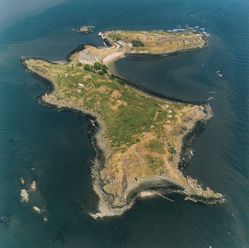 Oblique aerial view,  showing a general view of the island, with Inchcolm Abbey and four coastal batteries visible, taken from the W,
