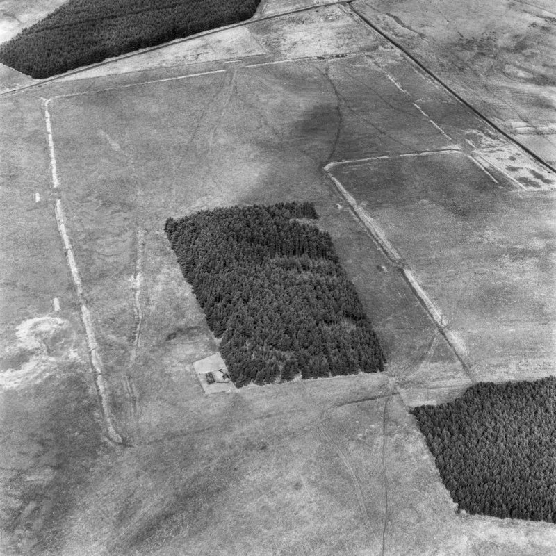 Pennymuir, oblique aerial view, taken from the SSW, centred on two Roman Temporary Camps and a linear earthwork. An area of rig and the course of 'Dere Street' are visible in the top right-hand corner of the photograph.