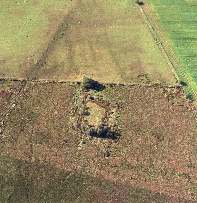 Oblique aerial view centred on the homestead moat, taken from the SSE.